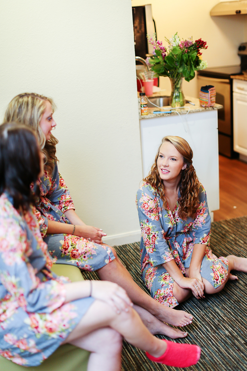 Matching floral bridesmaid robes. Photo by Jalapeno Photography.