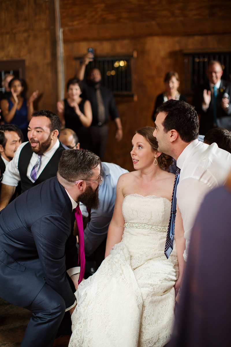 Jewish chair dance at Cassie and Phil's Bluemont Vineyard wedding by Jalapeno Photography.