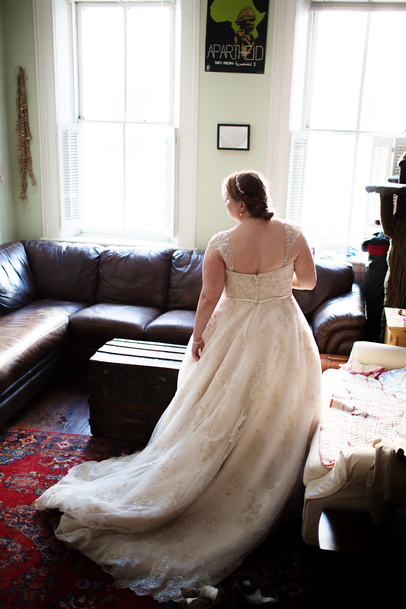 Plus-sized bride prepares for her wedding day in January in Old Town Alexandria.