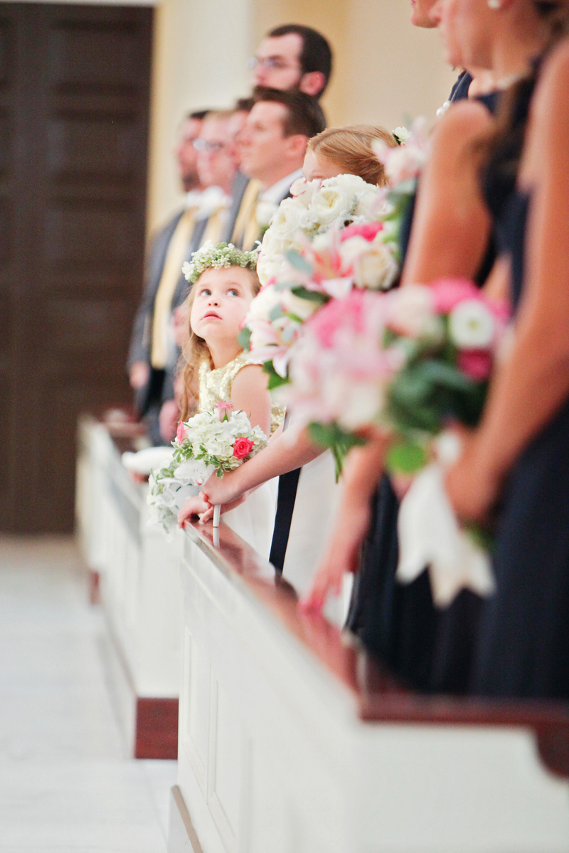 Flower girl at a Catholic wedding mass in Baltimore, MD. The church is the Basilica of the National Shrine of the Assumption of the Blessed Virgin Mary. The photographer was Jalapeno Photography.