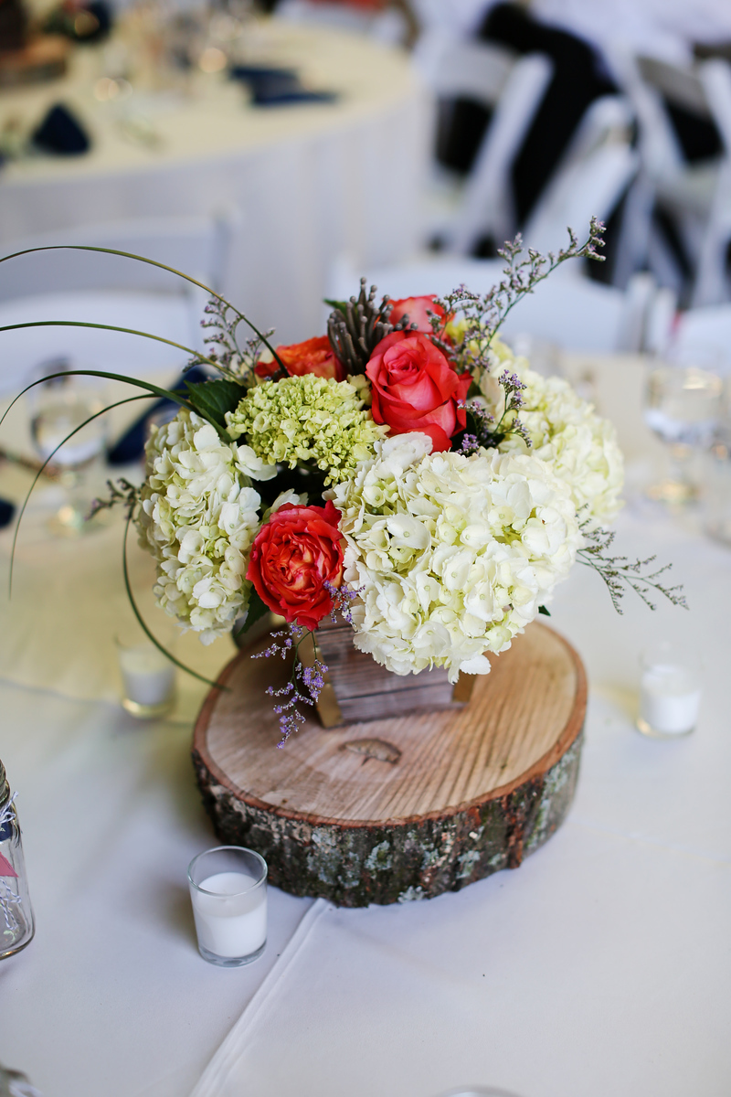 Roughcut centerpieces at the Robin Hill Farm and Vineyards wedding. Elegant barn wedding photos by Jalapeno Photography.